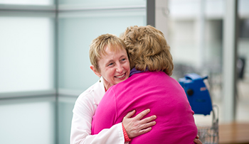Why Hollings - Physician hugging patient