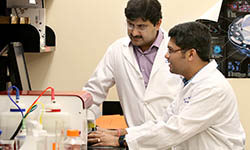 Dr. Shikhar Mehrotra works with a colleague in the lab